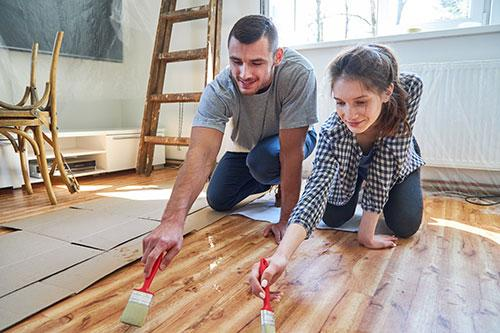 Couple staining floor